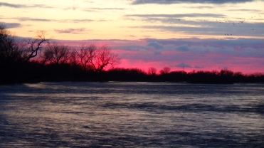Fire pink sunset on the Platte